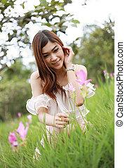pretty asian woman in siam tulip flower field