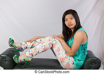 Asian woman sitting on a bench