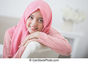 pretty asian woman wearing hijab - portrait of attractive...