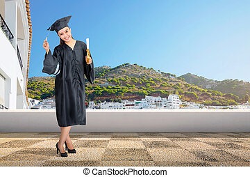 Pretty asian woman with graduation cap and diploma scroll