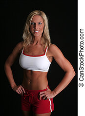 Pretty athlete smiling - A pretty blond athlete stands ...