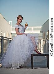 Pretty attractive twenties caucasian bride woman wearing wedding gown