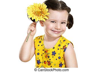 pretty baby girl with a yellow flower in her hand