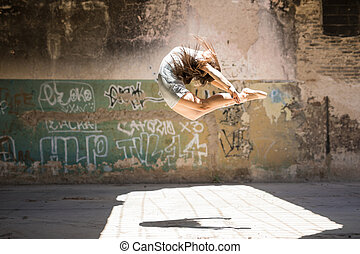Pretty ballerina jumping and performing