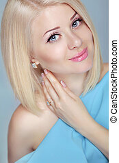 Pretty Beautiful blonde woman with short hair styling. Eyes makeup.