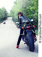 Pretty biker - Pretty girl in the leather jacket is looking ...