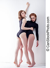 Pretty bisexual models posing in studio