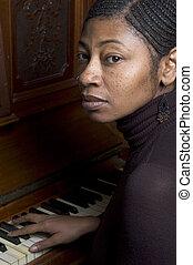 pretty black woman at piano