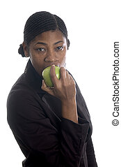 pretty black woman eating apple