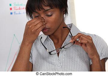 pretty black woman having migraine