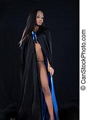 Pretty black woman in a cape