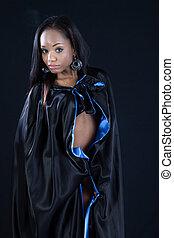 Pretty Black woman in black cape