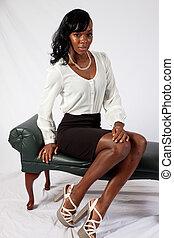 Pretty black woman in white blouse