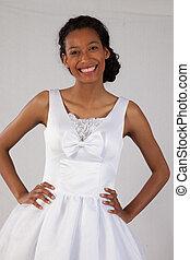 Pretty black woman in white dress