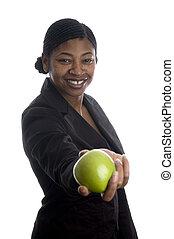 pretty black woman offering apple