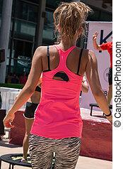Pretty Blond Girl doing Fitness on Mini Trampoline