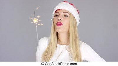 Pretty blond girl enjoy chrismas with sparkler