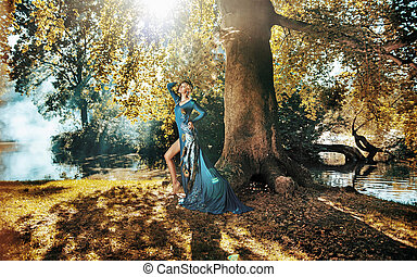 Pretty blond lady posing in the autumn forest