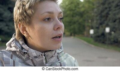Pretty blond short hair girl emotionally talking - Pretty...