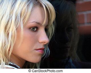 Pretty blond teen profile portrait outdoors window