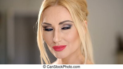 Pretty Blond Woman Face with Hand on the Chin