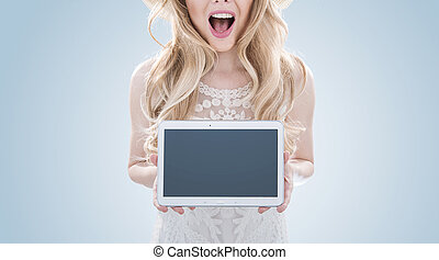 Pretty blond woman holding a tablet