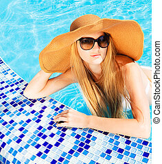 Pretty blond woman in a swimming pool