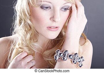 pretty blond woman in fashion