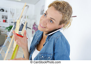 pretty blond woman on the phone while working at home