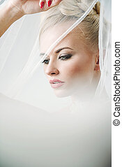 Pretty blond woman wearing a light veil
