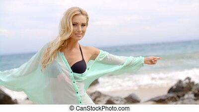 Pretty Blond Woman Wearing Light Mint Beachwear