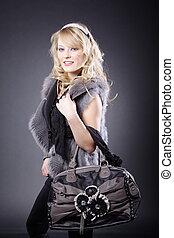 pretty blond woman with handbag
