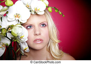 pretty blond woman with orchid