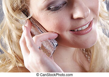 pretty blond woman with phone
