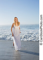 Pretty blonde at the beach in white sundress