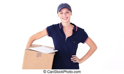 Pretty blonde delivery woman smiling at camera on white...