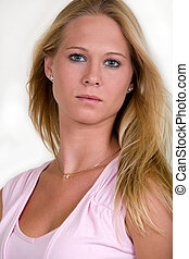 Pretty blonde face - Close up of beautiful blond hair blue...