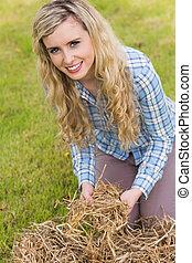 Pretty blonde feeling yellow straw