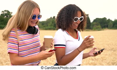Pretty blonde girl and mixed race teenager young women...