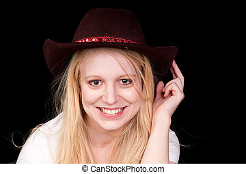 Pretty blonde girl in a cowboy hat