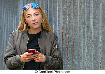 Pretty Blonde Girl Teenager Using Smart Phone