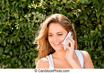 Pretty blonde girl with a mobile