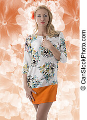 pretty blonde girl with flower in the hair clothing dress with floral pattern