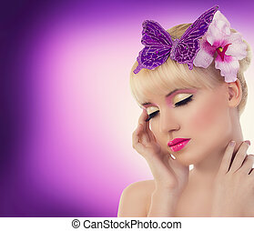 Pretty blonde girl with orchid flower and butterfly