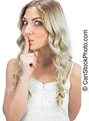 Pretty blonde hiding secret - Pretty blonde on white...
