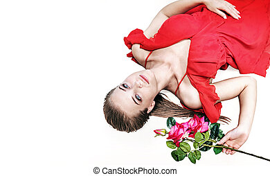 Pretty blonde holding a rose - isolated portrait