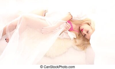 Pretty blonde in white bed