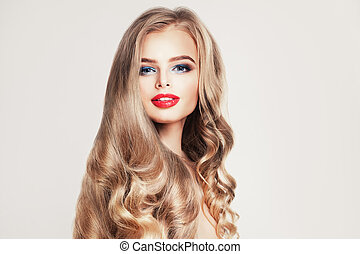 Pretty blonde model woman with long healthy curly hair on white
