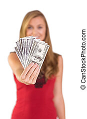 Pretty blonde showing wad of cash on white background
