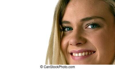 Pretty blonde smiling at the camer